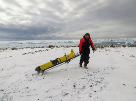 Dr Damien Guihen with an ocean glider owned by the University of California, Davis.